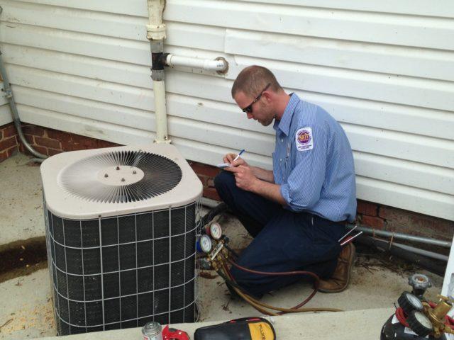 Hvac tech performing maintenance