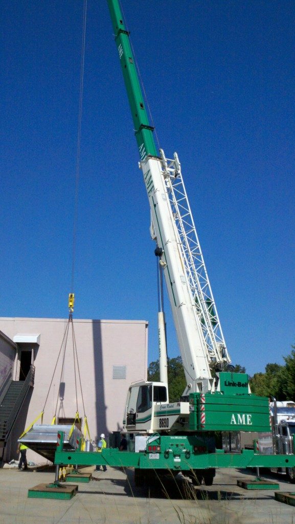 Commercial HVAC installation with a crane in Charlotte NC